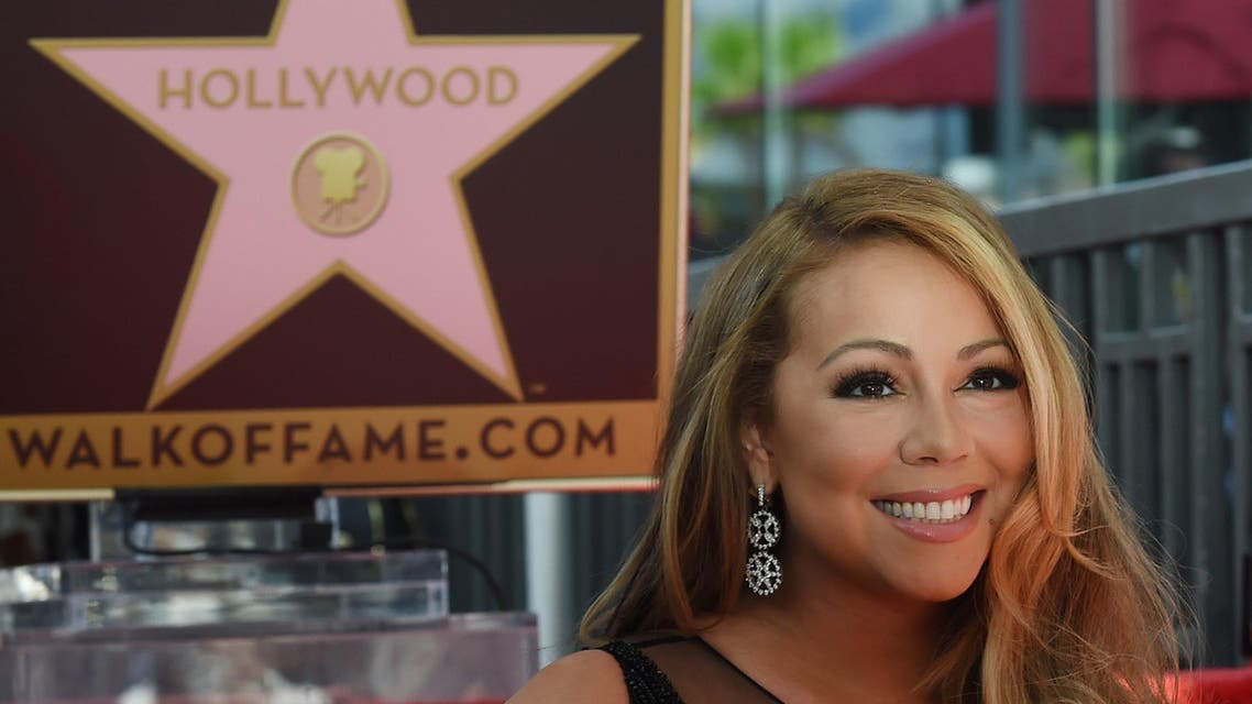 MRR5532 - Hollywood, California, UNITED STATES : Singer Mariah Carey is honored with the 2,556th star on The Hollywood Walk of Fame in Hollywood, California on August 5, 2015. Mariah Carey is the best-selling female artist of all time with more than 200-million albums sold so far and 18 Billboard Hot 100 No. 1 singles. AFP PHOTO/MARK RALSTON
