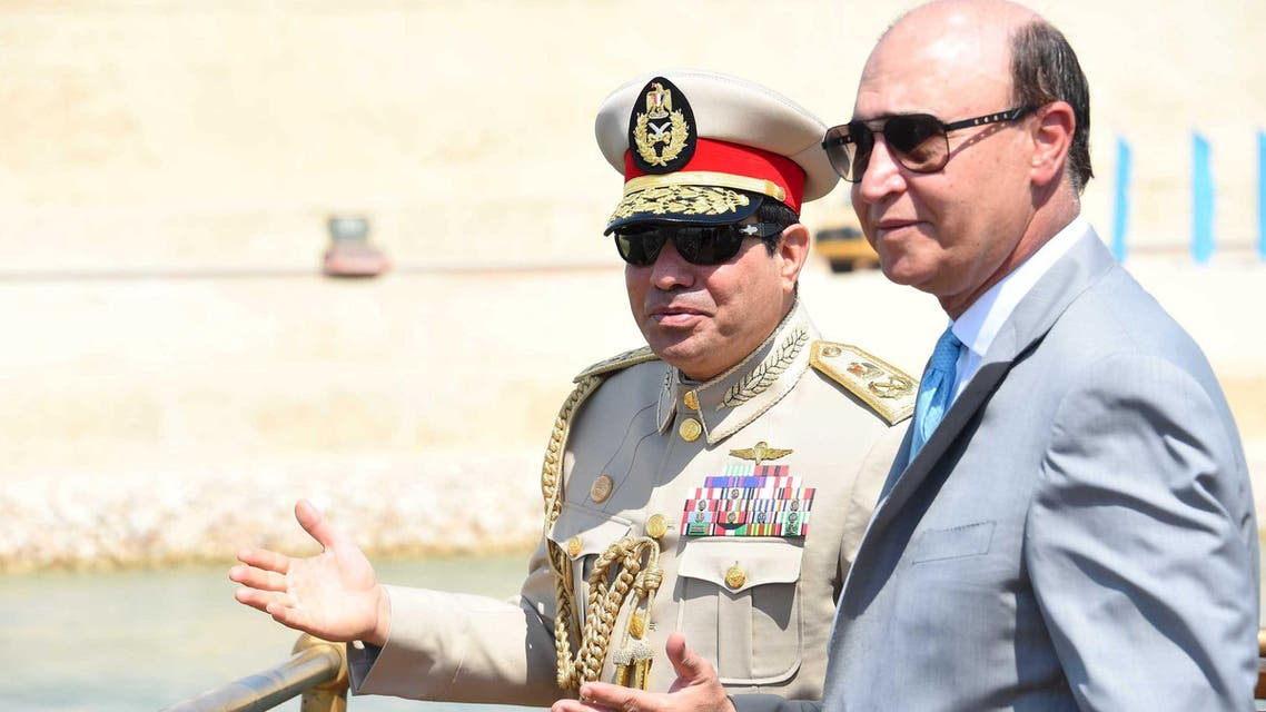 Egyptian President Abdel Fattah al-Sisi (L) talks to Mohab Mameesh, chairman of the Suez Canal Authority, as they attend the celebration of an extension of the Suez Canal in Ismailia, Egypt, August 6, 2015. Egypt will open an expansion to the Suez Canal to great fanfare on Thursday, the centrepiece of al-Sisi's plans to revitalise the country's economy after years of damaging political turmoil. In this handout courtesy of the Egyptian Presidency. REUTERS/The Egyptian Presidency/Handout