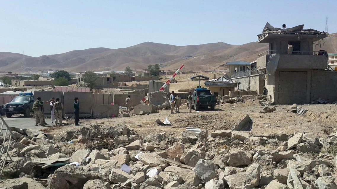 Afghan security forces keep watch after a suicide attack in Logar