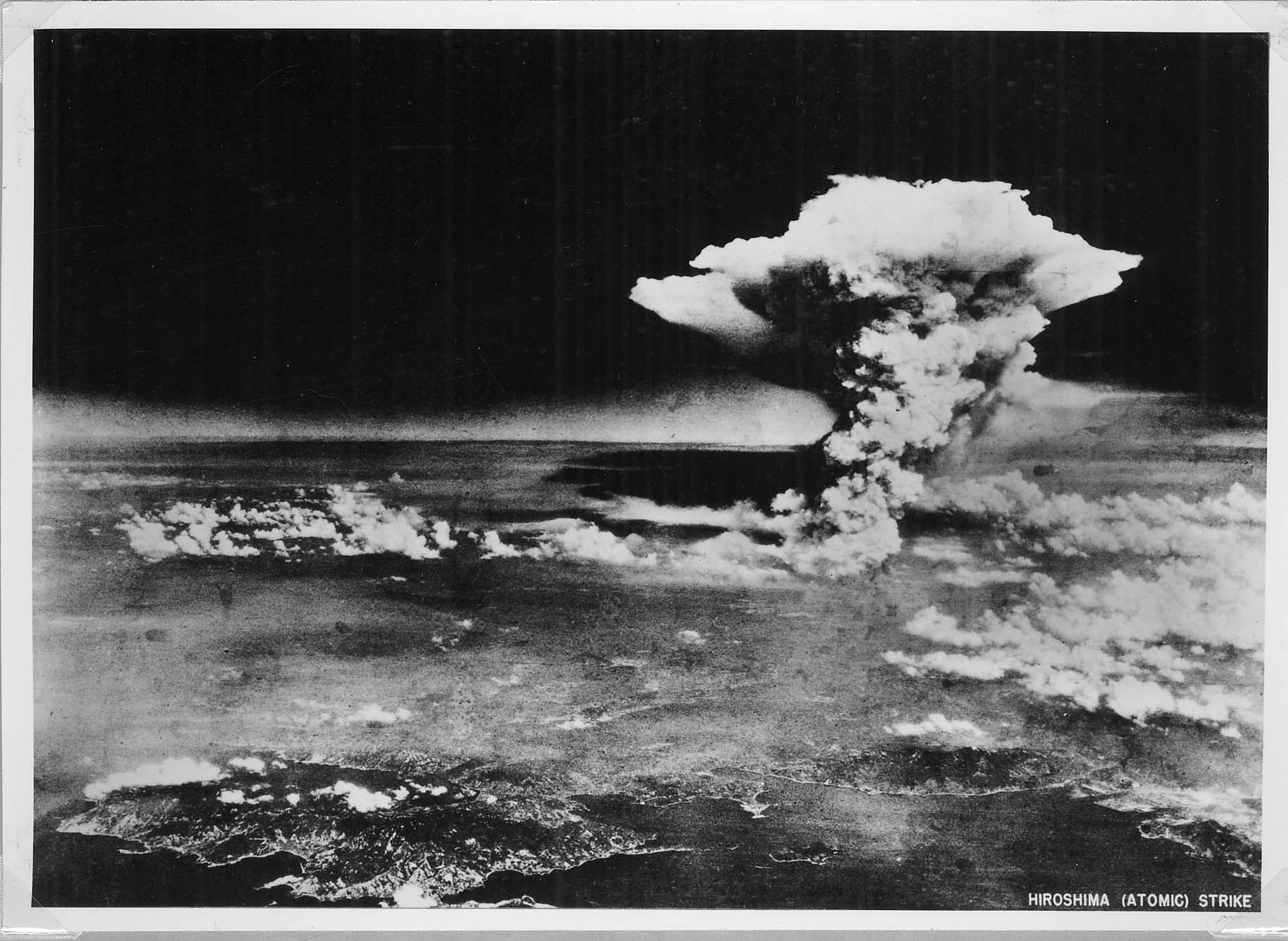 An atomic cloud billows above Hiroshima city following the explosion of the first atomic bomb to be used in warfare in Hiroshima, in this handout photo taken by the U.S. Army on August 6, 1945, and distributed by the Hiroshima Peace Memorial Museum. The words written on the photo are from the source. Mandatory credit REUTERS/U.S. Army/Hiroshima Peace Memorial Museum/Handout via Reuters