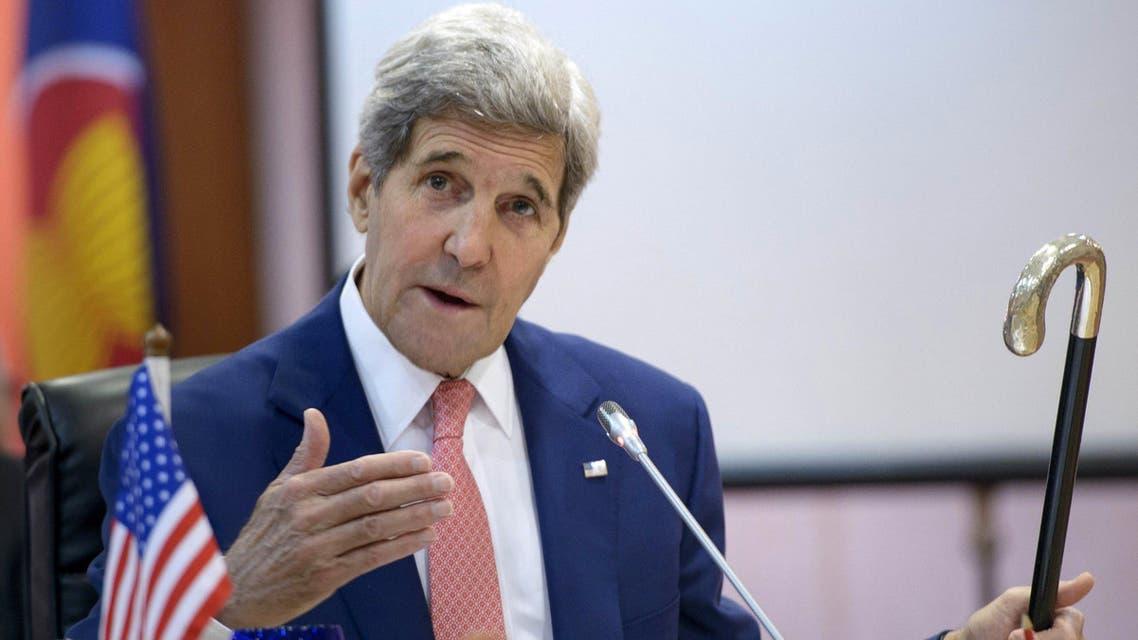 US Secretary of State John Kerry holds up Joseph Kennedy's cane