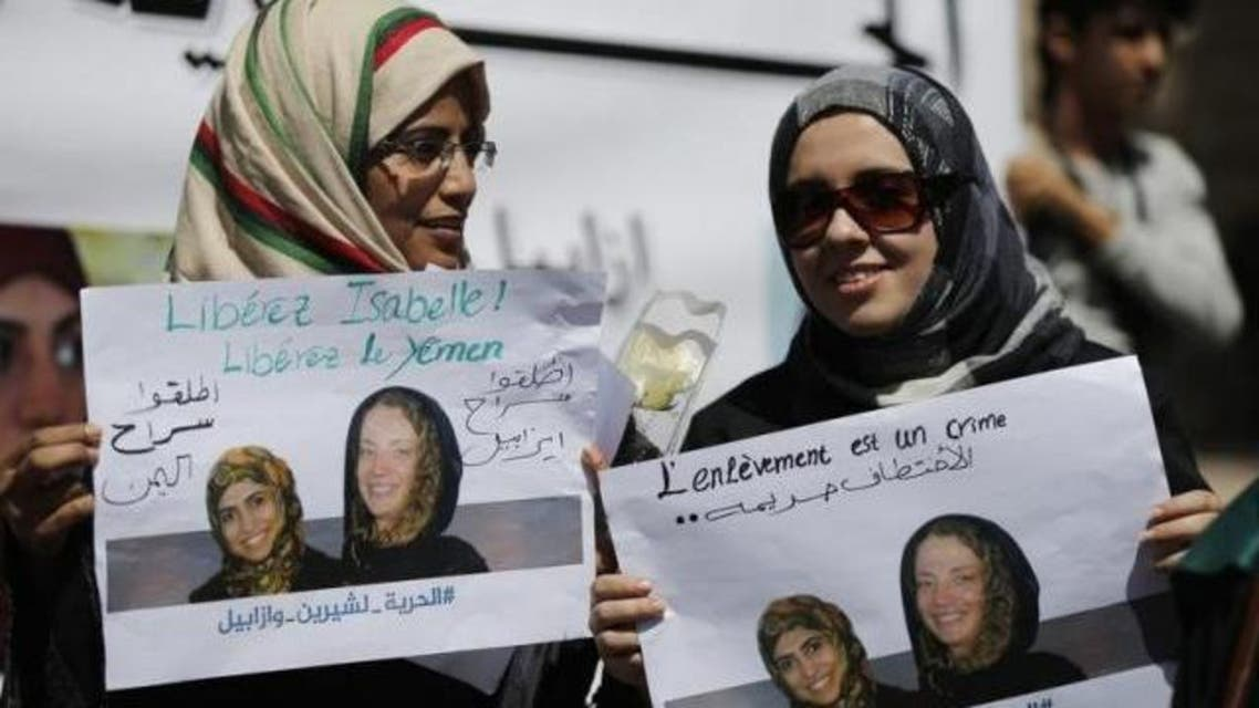 Women hold posters of Frenchwoman, Isabelle Prime (R) and her Yemeni translator Shereen Makawi during a protest to demand their release in Sanaa March 9, 2015. Reuters/Khaled Abdullah