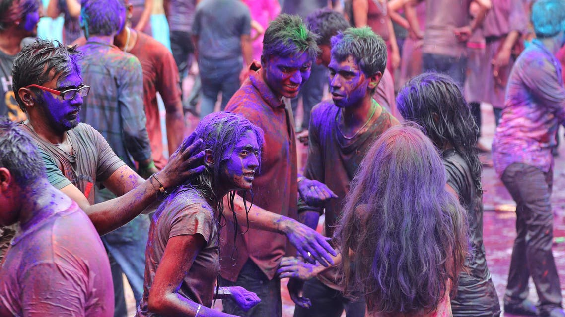 An Indian boy smear colored powder on a girl as they celebrate Holi in Bangalore, India, Friday, March 6, 2015. Holi, India's joyful and colorful celebration of the arrival of spring along with several religious myths and legends, has long ago ceased to be only a Hindu festival. The streets and lanes across most of India turn into a large playground where people off all faiths throw colored powder and water at each other. (AP Photo/Aijaz Rahi)