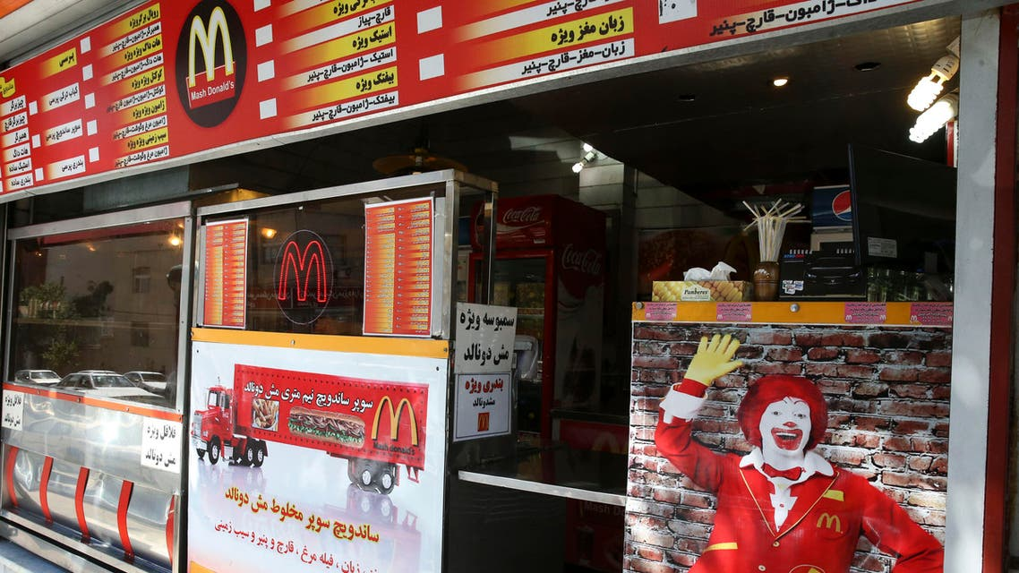 """In this Wednesday, Aug. 5, 2015 photo, Iran's fast food restaurant """"Mash Donald's,"""" a knock-off version of McDonald's, sells burgers and fries in western Tehran, Iran.  (AP)"""