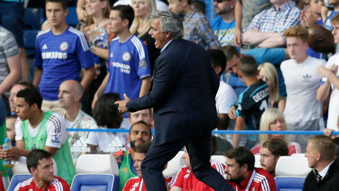 Jose Mourinho shouts across the pitch as Chelsea's Eden Hazard lies apparently injured following a foul during the English Premier League soccer match between Chelsea and Swansea City at Stamford Bridge, London, Saturday Aug. 8, 2015. (AP)