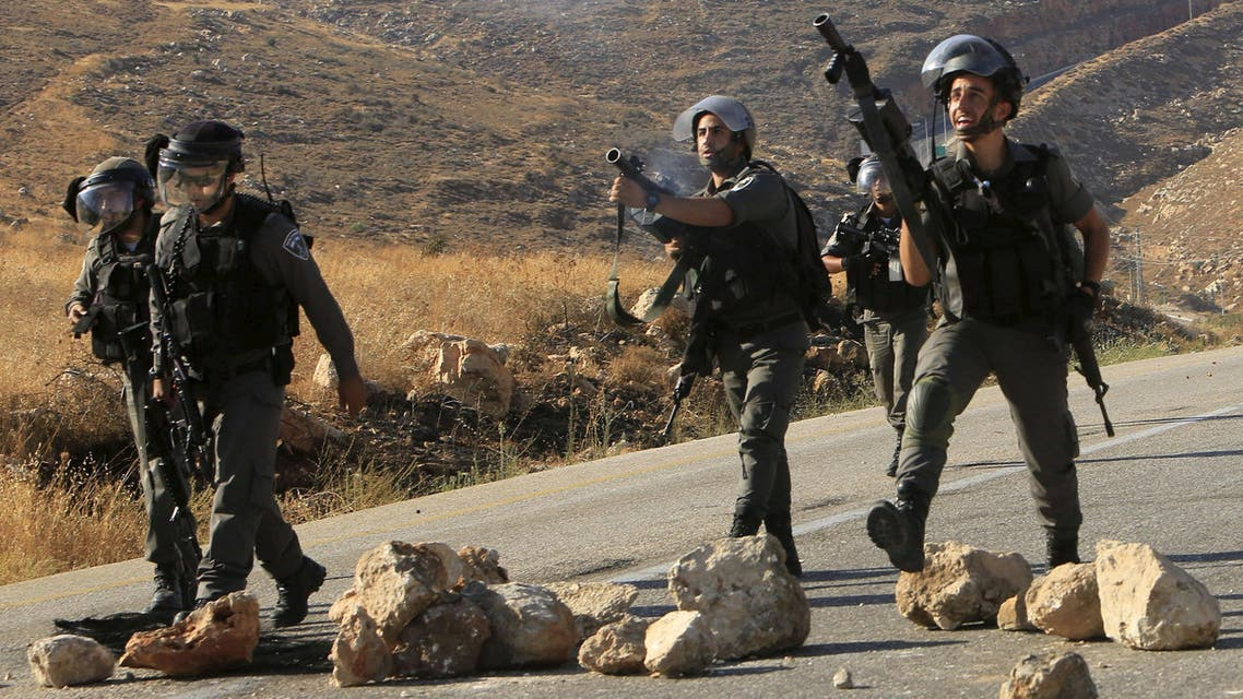 Israeli border police fire tear gas canisters during clashes with Palestinian protesters following the funeral of Palestinian Saad Dawabsheh in Duma near Nablus. (Reuters)