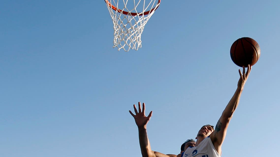 Bet Yosef of Israel shoots as Sergey Krasavtsev of Russia tries to block him during a basketball game for the 3X3 World basketball Championship in front of Zappeion hall in Athens, Saturday Aug. 25, 2012. (AP Photo/Kostas Tsironis)