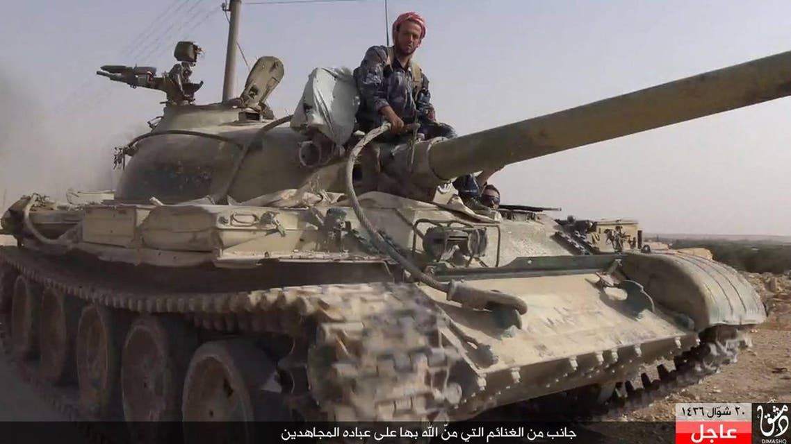 In this picture released Wednesday, Aug. 5, 2015 by the Rased News Network a Facebook page affiliated with Islamic State militants, an Islamic State militant sits on a tank they captured from Syrian government forces, in the town of Qaryatain southwest of Palmyra, central Syria. (File photo: AP)
