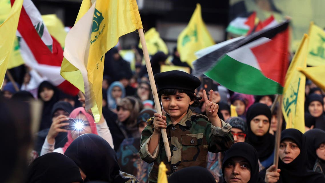 A Lebanese boy holds a Hezbollah flag during a rally to mark Al-Quds (Jerusalem) day, in the southern suburb of Beirut, Lebanon, Friday, July 10, 2015. (AP)