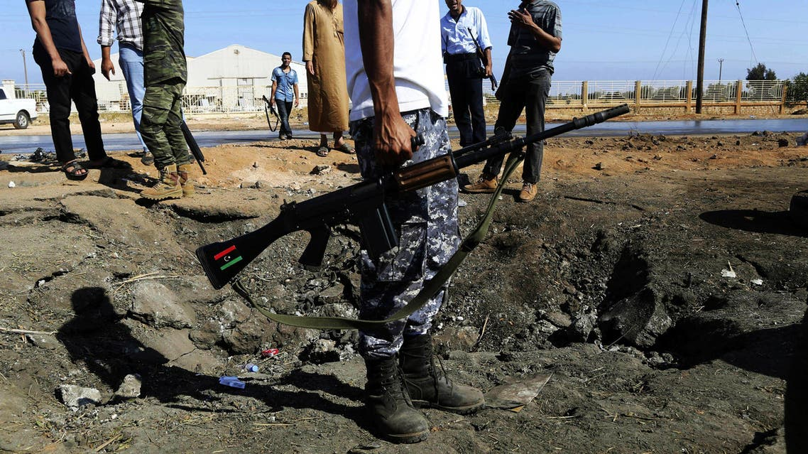 Army personnel look at the site of an explosion at an army checkpoint in Barsis, east of Benghazi. (File: Reuters)