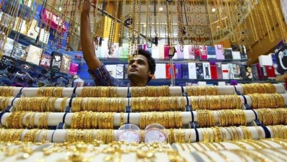 A salesman arranges jewellery at a shop at the gold souk in Deira, April 17, 2013. (Reuters)