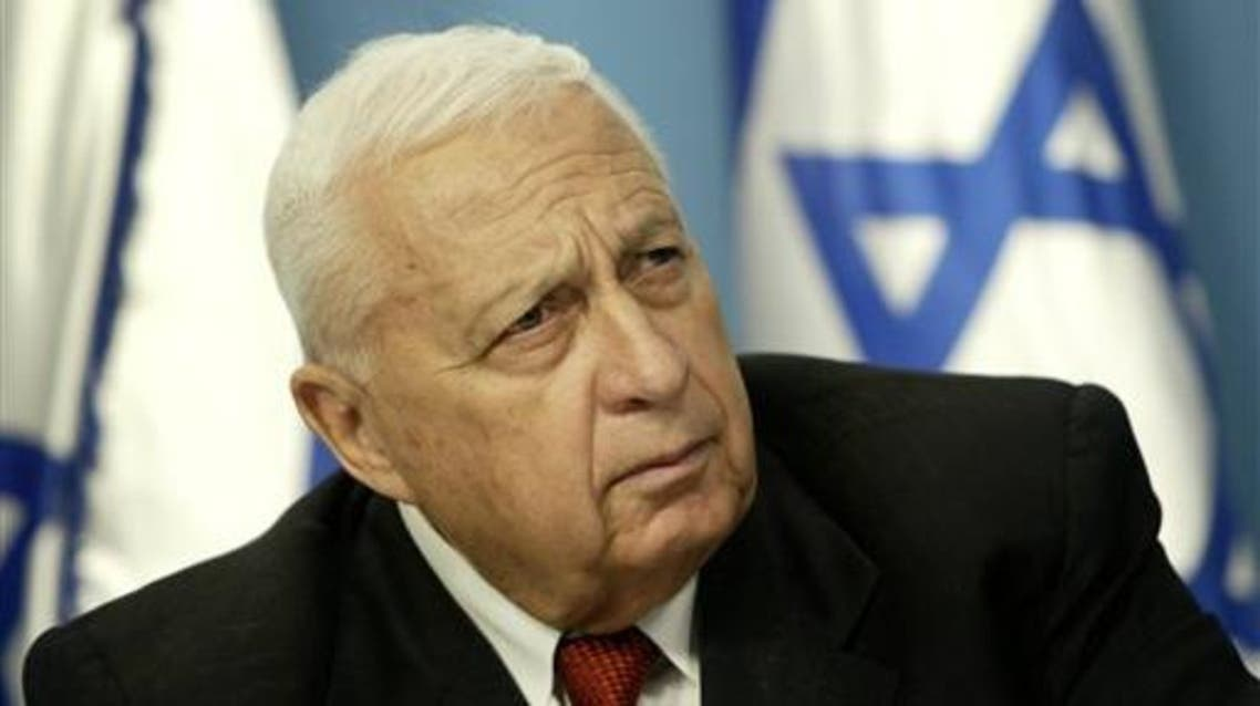 In this May 16, 2004, file photo, Israeli Prime Minister Ariel Sharon pauses during a news conference in his Jerusalem office regarding education reform. Sharon, the hard-charging Israeli general and prime minister who was admired and hated for his battlefield exploits and ambitions to reshape the Middle East, died Saturday, Jan. 11, 2014. The 85-year-old Sharon had been in a coma since a debilitating stroke eight years ago. (AP Photo/Oded Balilty, File)
