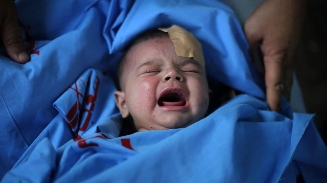 A Palestinian baby, wounded by an Israel bombardment on Rafah, is taken to Kuwaiti Hospital in Rafah, Gaza on August 4, 2014. (AFP)