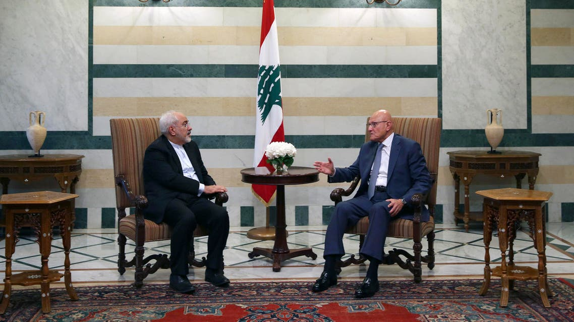 Lebanese Prime Minister Tammam Salam, right, meets with Iranian Foreign Minister Mohammad Javad Zarif, left, at the government palace in Beirut, Lebanon, Tuesday, Aug. 11, 2015. Zarif is holding talks with Lebanese officials before proceeding on to Damascus, Syria. (AP Photo/Bilal Hussein)