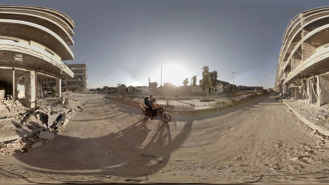 This image provided by Ryot shows a scene from a virtual reality short film of Syrians traveling on the street near the Aleppo Bridge for safety from the snipers targeting the condensed area in Syria. Three months after debuting VR footage filmed in Nepal after an earthquake devastated the country, Ryot is releasing an immersive three-minute short film on Tuesday, Aug. 11, 2015, that was captured on the war-torn streets of Aleppo, Syria. The film's creator, Christian Stephen, said he captured the footage using six cameras and a 3D-printed gimbal. (Christian Stephen/Ryot via AP)