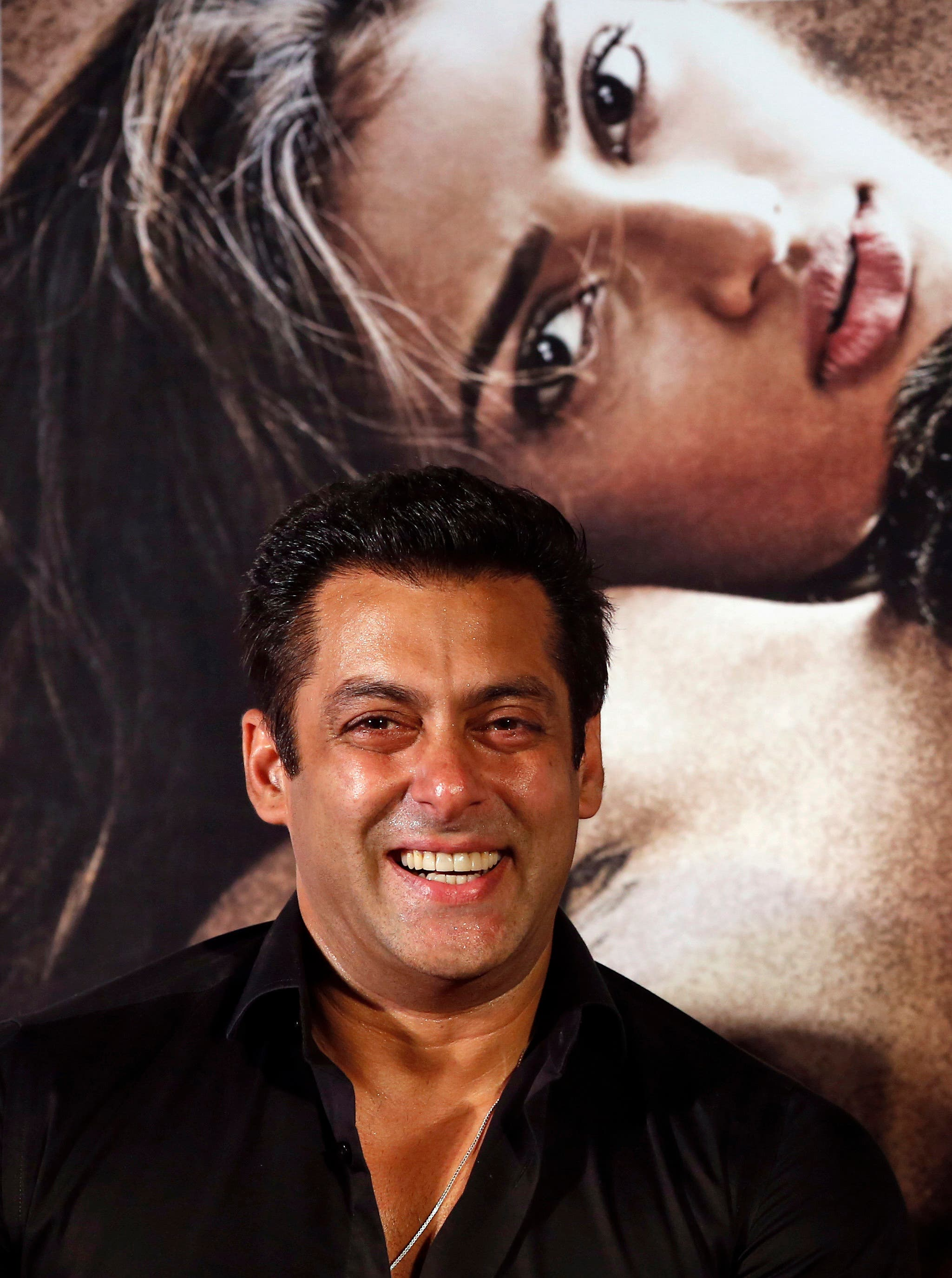 """Indian Bollywood actor Salman Khan laughs during the trailer launch of his movie """"Hero"""" in Mumbai, India, 2015. (AP)"""