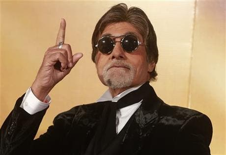 """Indian Bollywood superstar Amitabh Bachchan gestures during the trailer launch of his film """"Shamitabh"""" in Mumbai, India, 2015. (AP)"""