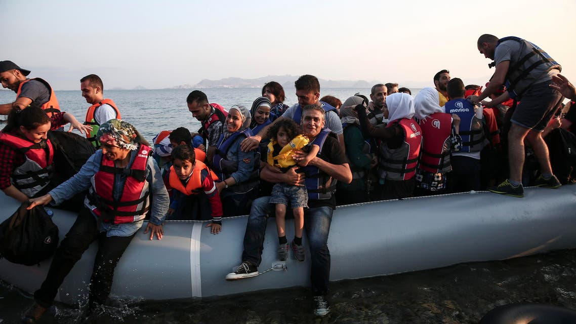 Migrants arrive at the coast on a dinghy after crossing from Turkey, at the southeastern island of Kos, Greece, Tuesday, Aug. 11, 2015.  AP