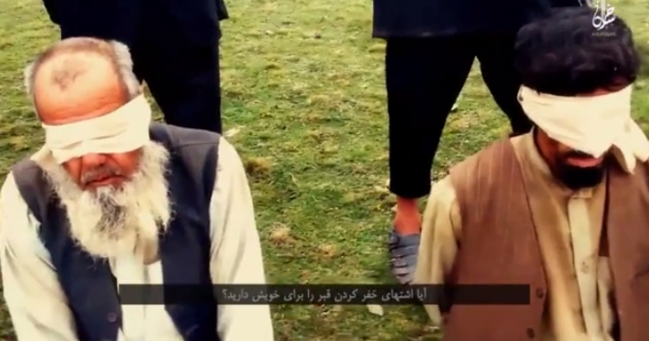 Seen here just moment before death, the blindfolded prisoners are forced to kneel (Video grab)