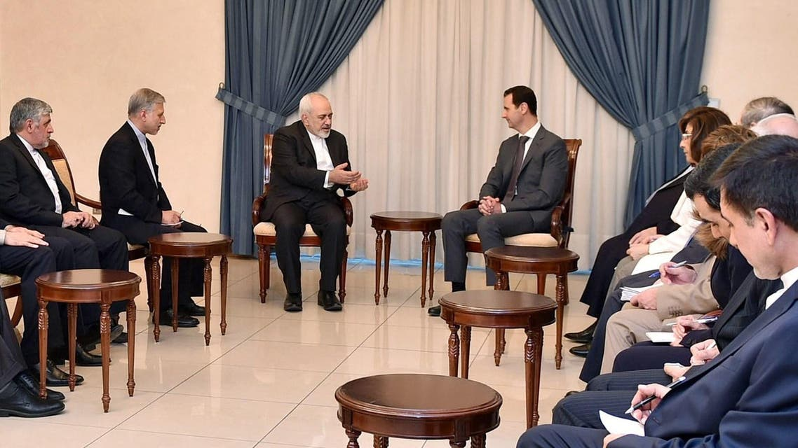 A handout picture released by the official Syrian Arab News Agency (SANA) shows Iranian Foreign Minister Mohammad Javad Zarif (C-L) meeting with Syrian President Bashar al-Assad (C-R) and other officials in Damascus on August 12, 2015. AFP