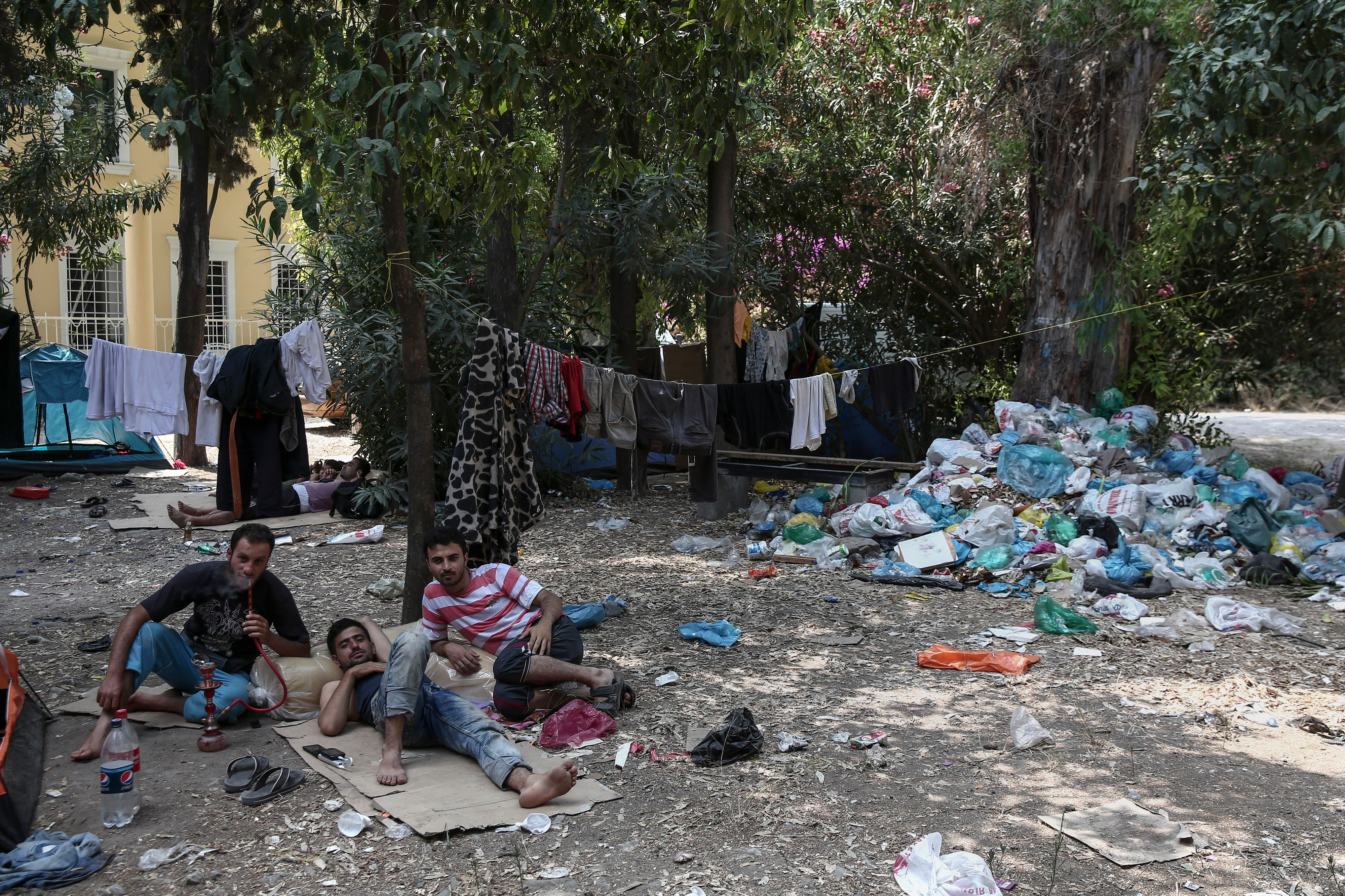 authorities on the eastern Aegean Sea island have been heavily criticized for their treatment of the migrants - mostly refugees from Syria. (AP)