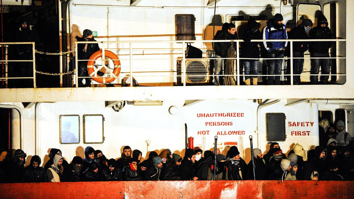 "CTL4785 - Gallipoli, -, ITALY : (FILES) A file picture taken on December 31, 2014 shows immigrants waiting early aboard the Moldovan-flagged ship Blue SKy M. in the port of Gallipoli, in southeastern of Italy. A Syrian man, suspected of being part of the crew of the ""Blue Sky M"", an old ship which smuggled migrants in Italy in late December, was arrested in Germany on August 12, 2015, Italian investigators announced. Some 800 illegal migrants arrived in Italy on December 31 after their boat was intercepted while drifting towards the coast of Corfu. AFP PHOTO / NUNZIO GIOVE"