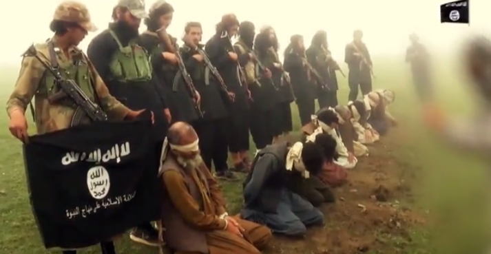 ISIS fighters seen posing with the men they are just about to blow up (Video grab)