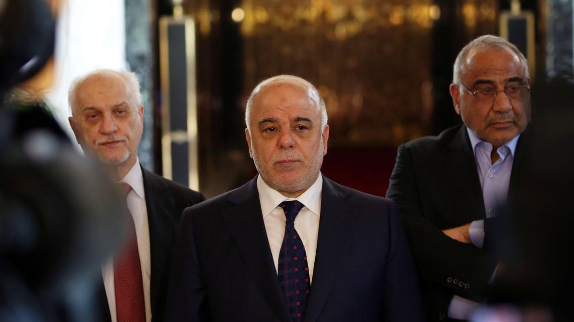 Iraqi Prime Minister Haider al-Abadi, center, holds a press conference before leaving to United States at Baghdad airport, Iraq, Monday, April 13, 2015.