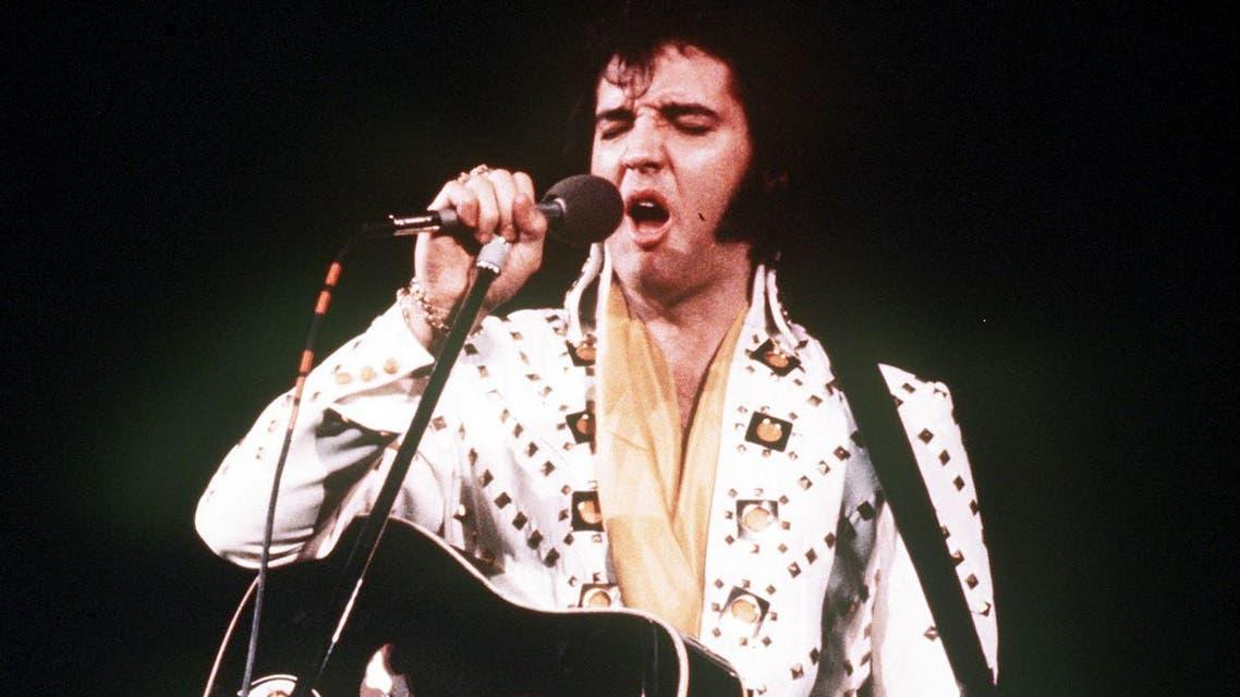 Elvis Presley sings during a 1973 concert.