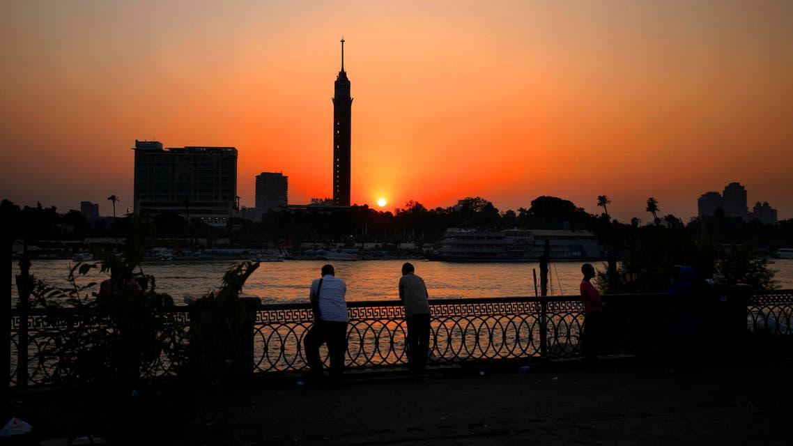 Egyptian men enjoy the sun setting over the Nile River in Cairo, Egypt, Wednesday, Aug. 5, 2015. (AP)
