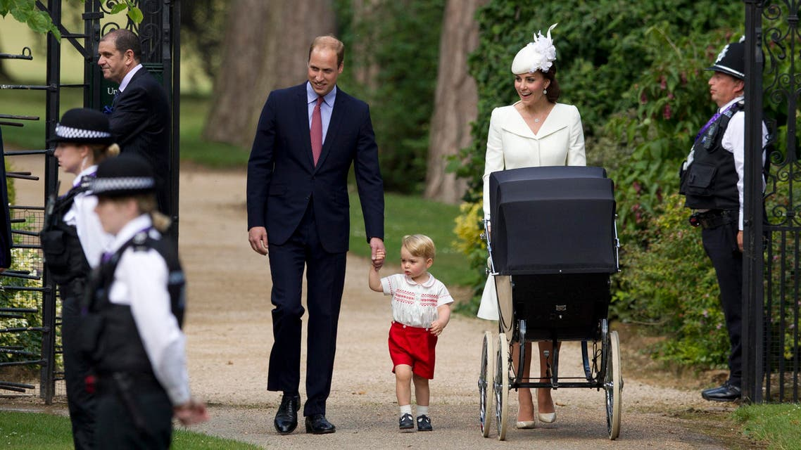 """In this file photo dated Sunday, July 5, 2015, Britain's Prince William, Kate the Duchess of Cambridge, their son Prince George walk with their daughter Princess Charlotte in a pram, during an official media event as they arrive for Charlotte's Christening at St. Mary Magdalene Church in Sandringham, England. Royal officials at Kensington Palace are urging all media organizations not to publish images of Prince George and Princess Charlotte, by some paparazzi photographers who are using increasingly dangerous tactics to snap images of the royals, which presents a risk """"in a heightened security environment.'' (AP Photo/Matt Dunham, FILE)"""