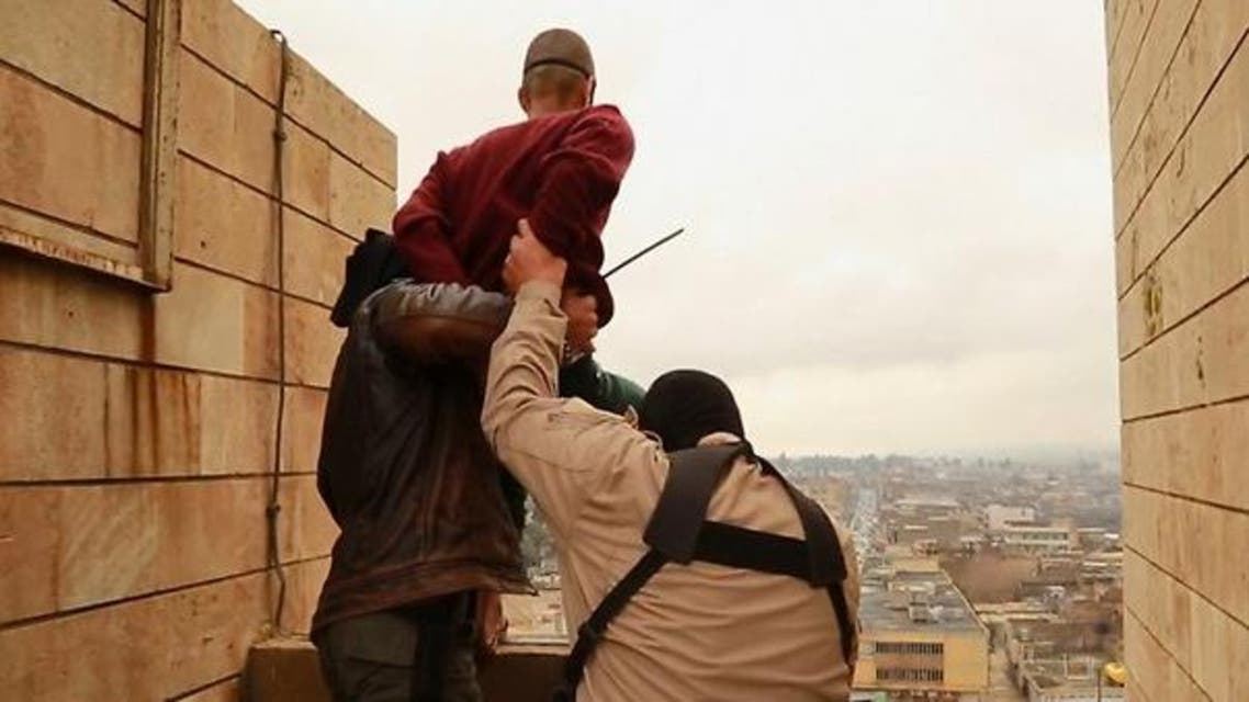 In December, IS posted photographs showing jihadists throwing a man off a rooftop and then stoning him to death because he was gay. (Via YouTube)