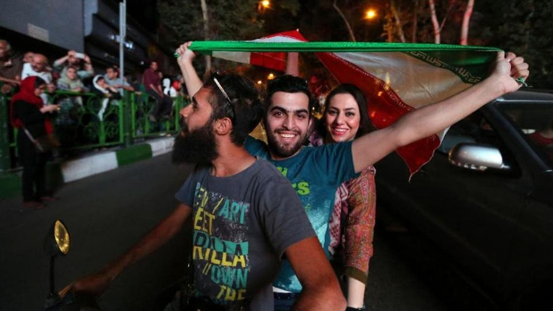 Many Iranians celebrated in the streets after Tehran's nuclear negotiating team struck a deal with world powers in Vienna last month (AFP Photo/Atta Kenare)