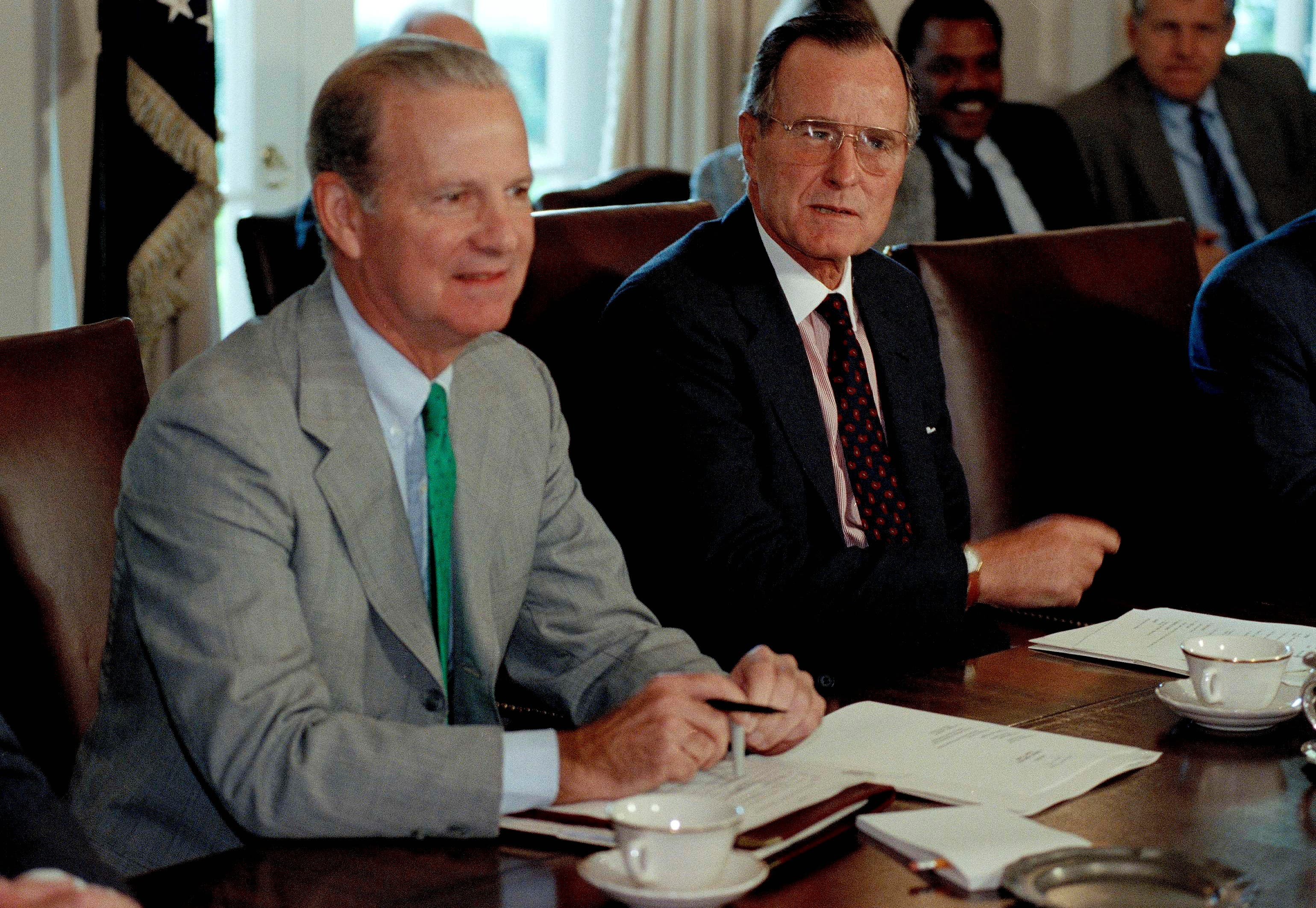 President George Bush and Secretary of State James Baker pose for photographers prior to a Cabinet meeting in the White House, Aug. 8, 1990. Bush dispatched American warplanes and ground troops to Saudi Arabia to join a multi-national military force. (File photo: AP)