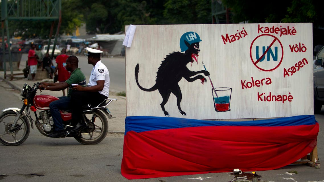 A free-standing mural depicting a U.N. peacekeeper as an animal is displayed in the median of a downtown street of Port-au-Prince, Haiti, Thursday Sept. 8, 2011. (AP)