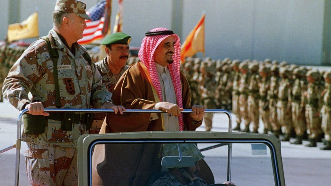 Gen. H. Norman Schwarzkopf accompanies Saudi arabian King Fahd as he reviews U.S. troops at an air base in eastern Saudi Arabia Jan. 7, 1991. This marked the first visit of the king to troops in the field since the August invasion of Kuwait by Iraq. (AP)