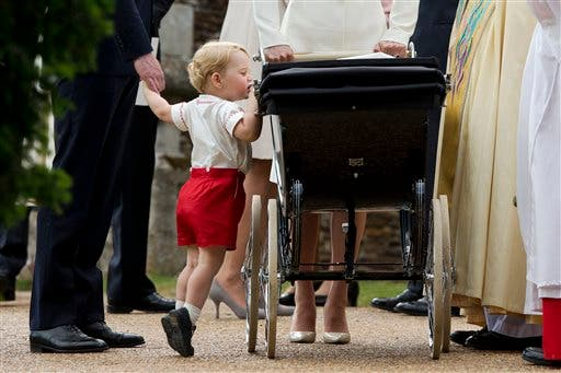 In this Sunday, July 5, 2015 file photo, Britain's Prince George gets up on tiptoes to peek into the pram of Princess Charlotte flanked by his parents Prince William and Kate the Duchess of Cambridge as they leave after Charlotte's Christening at St. Mary Magdalene Church in Sandringham, England. Britain's royals on Wednesday July 22 ,2015 celebrate the second birthday of George, the first child of Prince William and his wife, Kate. (AP Photo/Matt Dunham, file)