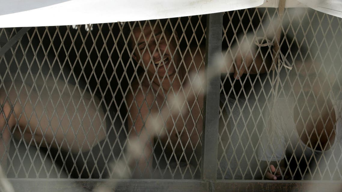 In this May 2, 2010 file photo, an Iraqi prisoner is seen at al-Muthanna prison in Baghdad, Iraq. Elite security forces controlled by the military office of Prime Minister Nuri al-Maliki of Iraq are operating a secret detention site in Baghdad, Human Rights Watch said Tuesday Feb. 1 2011. (AP )