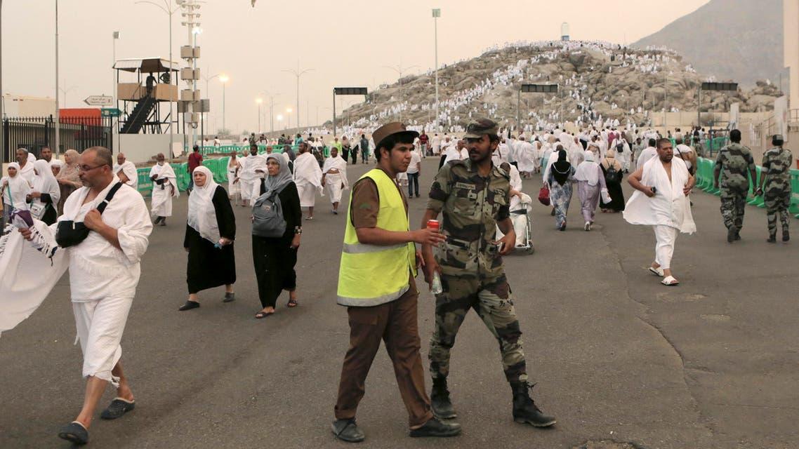 Saudi security forces patrol while Muslim pilgrims gather at the Plain of Arafat during hajj, near Mecca, Saudi Arabia, October 2, 2014. (AP)