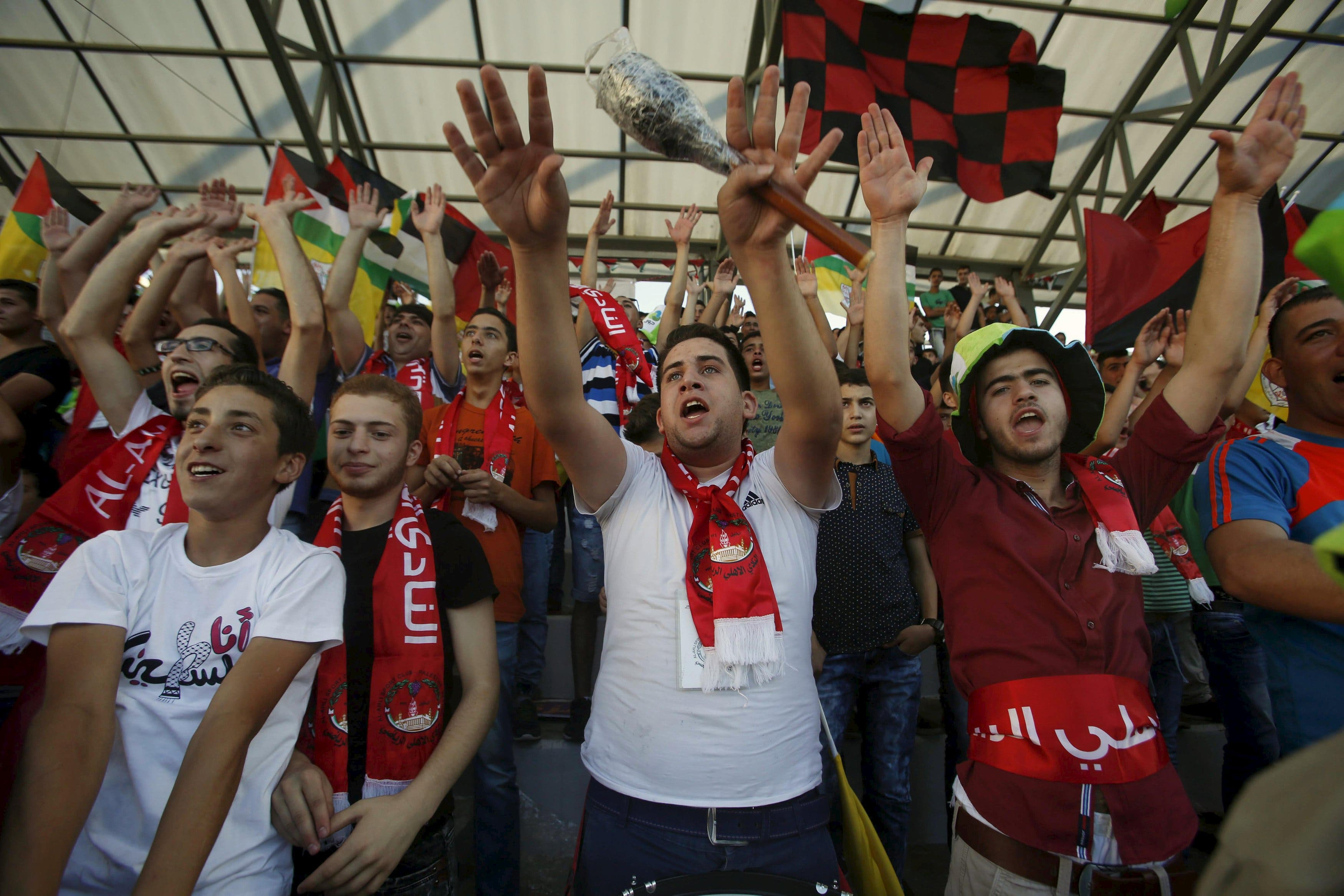 Fans of Hebron's Al-Ahly cheer and chant during their second leg of the Palestine Cup final soccer match against Gaza Strip's Shejaia at al-Hussien stadium in the West Bank city of Hebron August 14, 2015. REUTERS