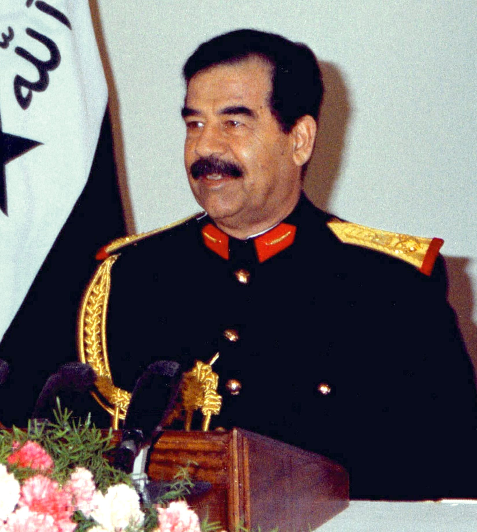 Iraqi President Saddam Hussein speaking during a 1997 address marking the 76th anniversary of the Iraqi forces (File photo Reuters)