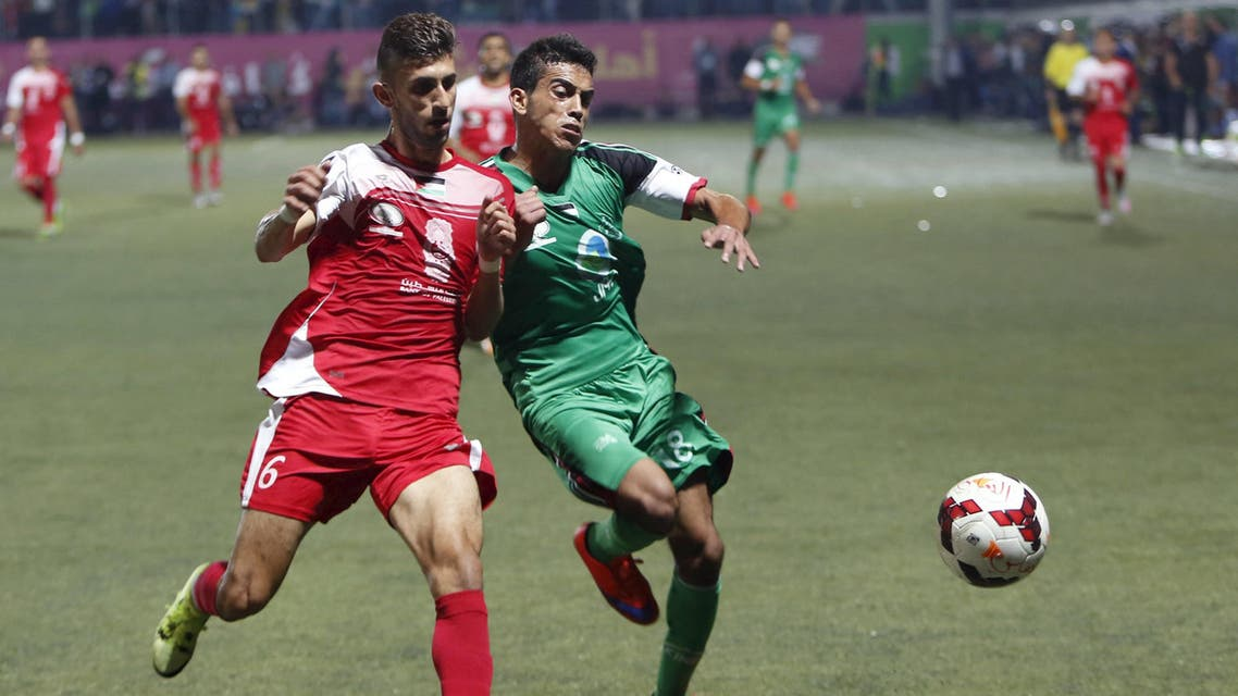 Palestinian Hebron's Al-Ahly's Deifallah fights for the ball with Gaza Strip's Shejaia's Wadi during their second leg of the Palestine Cup final soccer match at al-Hussien stadium in the West Bank city of Hebron. (Reuters)