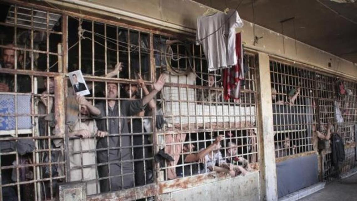Inmates are seen behind bars in Aleppo's main prison May 22, 2014. (Reuters)
