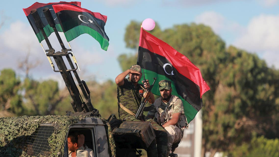 Members of the Libyan army give protection to a demonstration in support of the Libyan army under the leadership of General Khalifa Haftar, in Benghazi, Libya, August 14, 2015. REUTERS