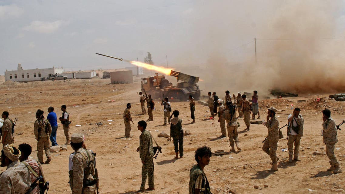 In this photo provided by Yemen's Defense Ministry, Yemeni army soldiers fire rockets at mountainous positions of al-Qaida militants at the town of Meyfaa, in the southern province of Shabwa, Yemen, Sunday, May 4, 2014. (AP)