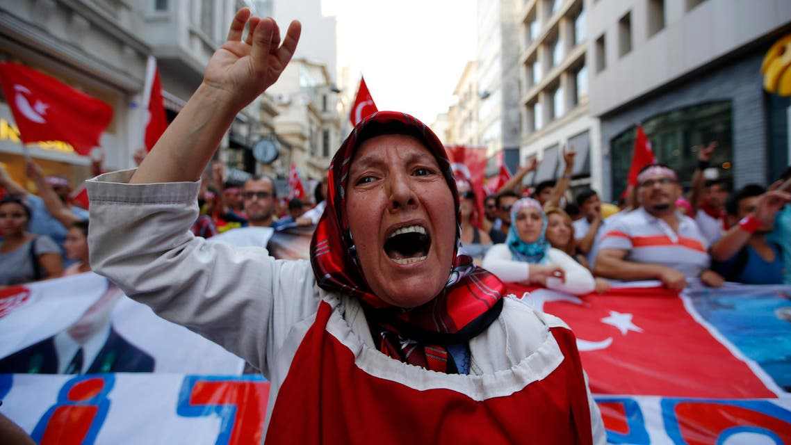 A group of Turkish nationalists chant slogans, protesting against against Kurdistan Workers' Party (PKK) militants' recent attacks on Turkish security forces, during a march in Istanbul, Sunday, Aug. 16, 2015.