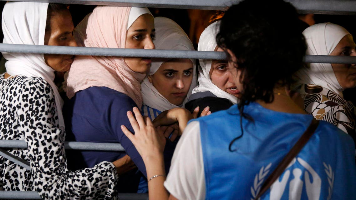 """Syrian refugees board the passenger ship """"Eleftherios Venizelos"""" at the port on the Greek island of Kos. (Reuters)"""