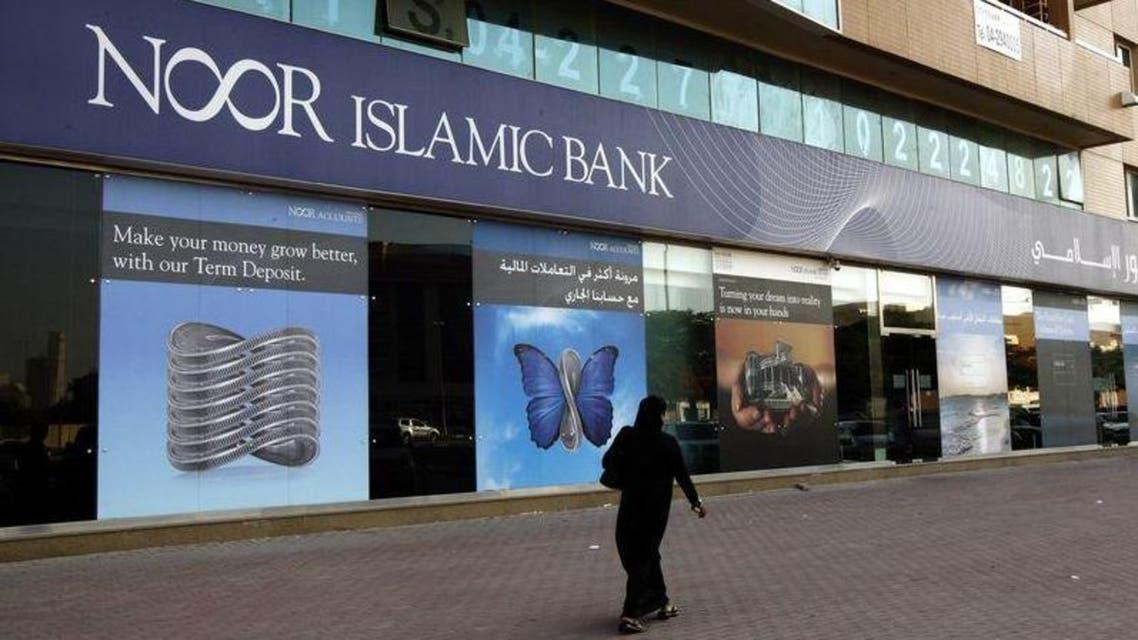 A woman walks past a branch of Noor Islamic Bank along Khalid Bin Al-Waleed Street in Dubai in this May 30, 2010 file photo. (Reuters)