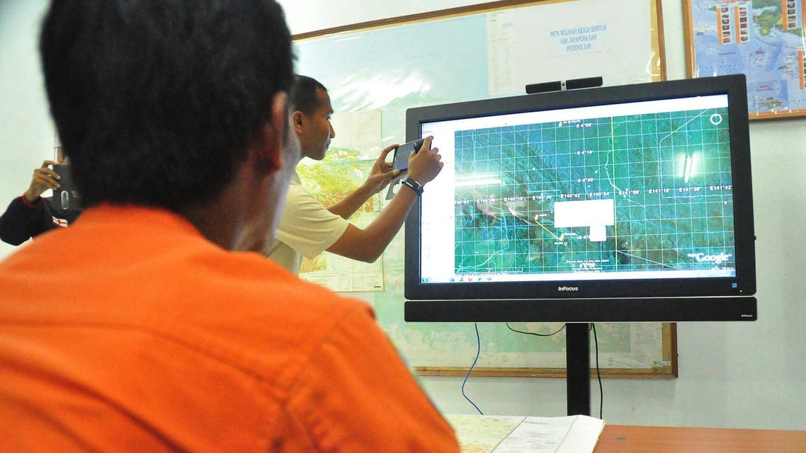 Indonesia's National Search and Rescue personnel view a terrain map in Jayapura in the eastern Indonesian province of Papua. (File: AFP)