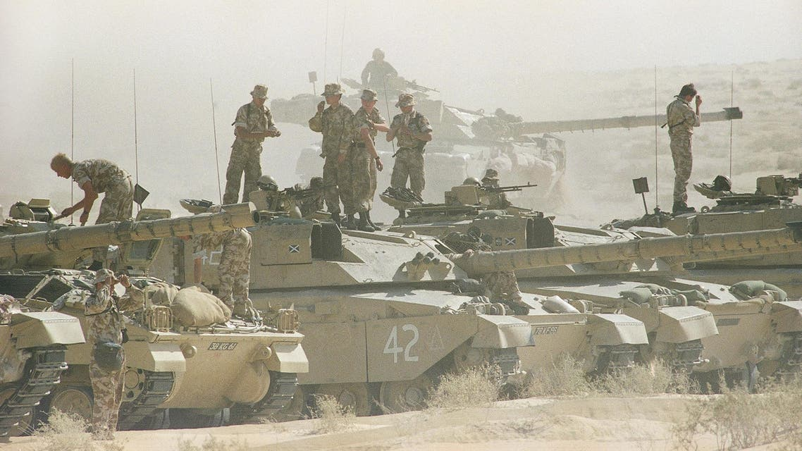 Tank crews with the British 7th Armoured Brigade stand atop their Challenger tanks after a simulated battle in the dusty eastern Saudi Arabian desert, Saturday, Dec. 1, 1990 in Saudi Arabia. (AP)